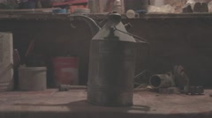 Putting old oil can on workbench - Flat image Stock Footage