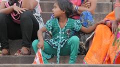 Hindu kid waiting for ceremony on ghats,Varanasi,India Stock Footage