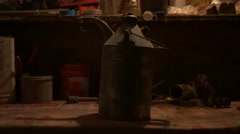 Putting old oil can on workbench - Graded image Stock Footage