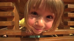 Close-up of cute funny 4 year-old girl having fun on the playground Stock Footage