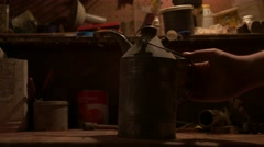 Close-up of oil canister lit with lantern - Graded image Stock Footage