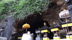 4k Entry of holy bat cave with relgious temple decoration Goa Lawah in Bali Stock Footage