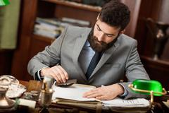 Lawyer or bankar or businessman  working in office Stock Photos