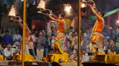 Priest at evening ceremony with burning candles,Varanasi,India Stock Footage