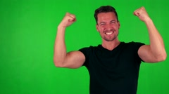 Young handsome caucasian man rejoices - green screen - studio Stock Footage