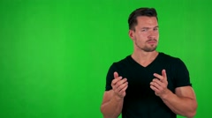 Young handsome caucasian man is suprised - green screen - studio Stock Footage