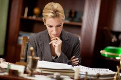 Lawyer or bankar or businesswoman  working in office Stock Photos