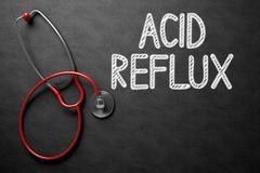 Acid Reflux Concept on Chalkboard. 3D Illustration Stock Illustration