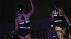 Sexy brunette go go girls in bikini suits dance on party in nightclub. Booty Stock Footage