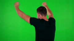 Young handsome caucasian man rejoices - shot on back - green screen Stock Footage