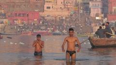 Young hindu men ritual bathing in Ganges river,Varanasi,India Stock Footage