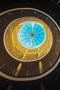 Modern architectural feature, round staircase and glass roof Stock Photos