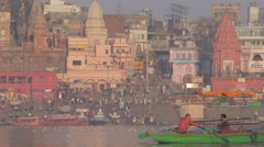 Rowing boat with indian tourists on Ganges river,Varanasi,India Stock Footage