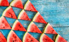 On a blue background flat triangles of watermelon Kuvituskuvat