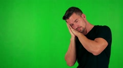 Young handsome caucasian man wakes up and he is suprised - green screen - studio Stock Footage