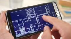 4K Looking at a Building Plan Blueprint on Smartphone Touchscreen Stock Footage