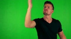 Young handsome caucasian man is angry (scold someone) - green screen - studio Stock Footage
