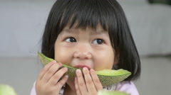 4K : Lovely Asian child girl eating delicious green melon Stock Footage