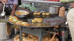 Popular potato snack being made,Varanasi,India Stock Footage