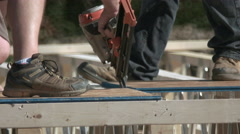 Carpenter Using Nail Gun for New Home Construction. Stock Footage