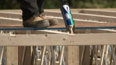Carpenter Using Wood Glue for New Home Construction. Stock Footage