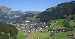 Aerial Shot of the valley of Engelberg in Switzerland in the alps, 4K UHD Stock Footage