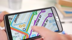 4K Looking at a City Map Plan on Smartphone Touchscreen Stock Footage