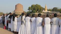 Sri Lankan pilgrims praying near Dhamekh Stupa,Sarnath,India Stock Footage
