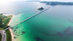 Aerial shot of bridge spanning island Stock Footage