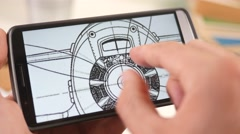4K Looking at a Technical Drawing Blueprint on a Smartphone Touchscreen Stock Footage