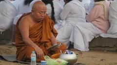 Monk praying with bowl,BodhGaya,Mahabodhi Temple Complex,India Stock Footage