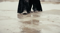 Dirty black boots, walking through the mud Stock Footage