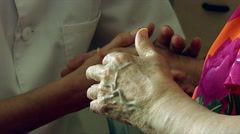 Nurse caring for senior citizen at retirement home Stock Footage