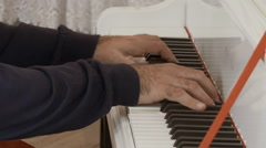 A man playing the piano. hands closeup Stock Footage