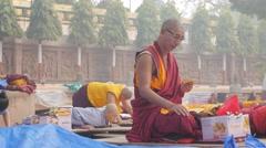 Tibetan monks praying,BodhGaya,Mahabodhi Temple Complex,India Stock Footage