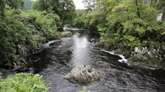 Betws-y-Coed Wales UK Snowdonia National Park river flowing through village Stock Footage
