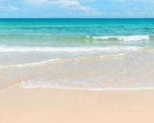 Clear azure sea and sandy beach Stock Photos
