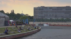 People relaxing at River Spree Beachclub - Spreebogen Stock Footage