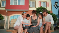 Family using digital tablet. grandmother, parents and children Stock Footage