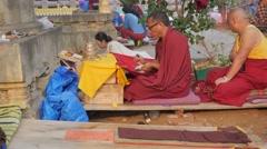 Tibetan woman prostrate,BodhGaya,Mahabodhi Temple Complex,India Stock Footage