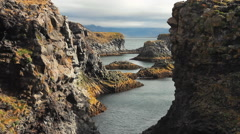 Gatklettur Arch Rock in Western Iceland. Stock Footage