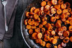 Roasted carrots on the pan Stock Photos