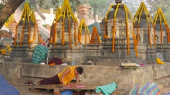 Monk prostrate praying,BodhGaya,Mahabodhi Temple Complex,India Stock Footage
