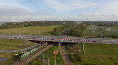 Aerial view of highway and railroad track Stock Footage