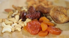 Close-up of dried apricots figs, dates, almonds cashew Stock Footage