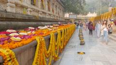 Pilgrims circle decorated temple,BodhGaya,Mahabodhi Temple Complex,India Stock Footage