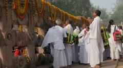 Pilgrims in white praying at wall,BodhGaya,Mahabodhi Temple Complex,India Stock Footage