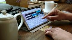 Shopping online on Skyskanner website. Stock Footage