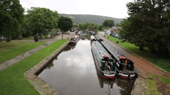 Long boats or barges on canal Pontcysyllte Aqueduct Llangollen Wales UK Stock Footage