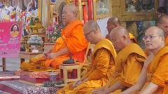 Buddhist monk teaching buddhism,BodhGaya,Mahabodhi Temple Complex,India Stock Footage